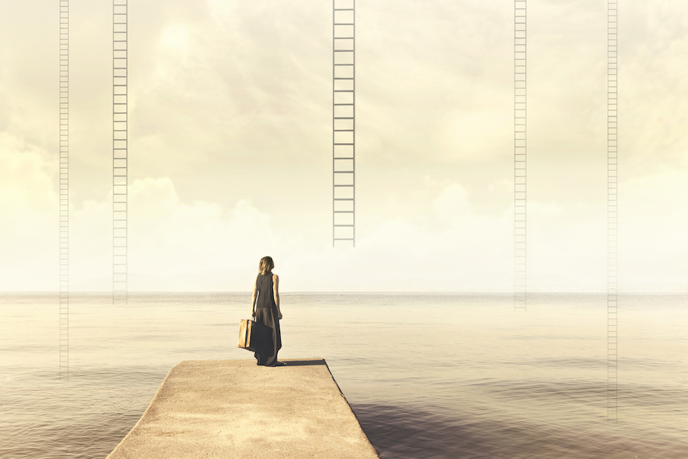 Surreal moment of a woman who has to choose which imaginary scale to climb to the sky